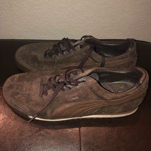Brown puma roma shoes.